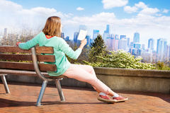 Woman read book in Seattle park Stock Photo