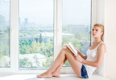 Woman read book Stock Photos