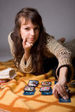 Woman read the cards stock photography