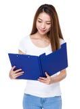 Woman read on clipboard Stock Photo