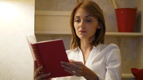 Woman read gripping novel book at home. Woman read facinating novel book at home. Girl enjoy reading interesting book. Classic literature concept stock footage