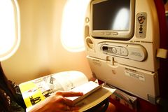 Woman read flight magazine scene. stock photography