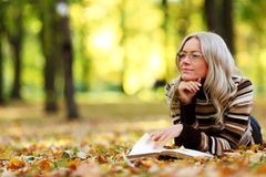 Woman Read In Park Stock Photos