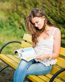 Woman read a magazine Stock Image