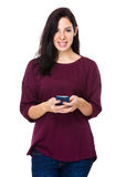 Woman read the message on phone Stock Image