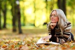 Woman read in park stock photos