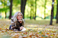 Woman read in park Stock Images
