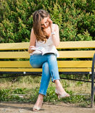 Woman read in park Stock Photo