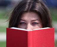 Woman read red book Royalty Free Stock Photo
