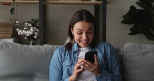 Woman read sms with great news feels happy enjoy moment