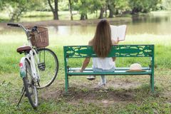 woman read text book at park Stock Photo