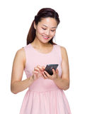 Woman read text message on mobile phone Stock Photos
