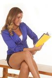 Woman read yellow book Stock Photos