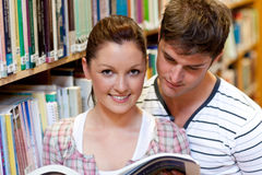Woman readin a book with boyfriend Royalty Free Stock Photo