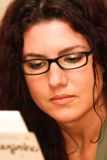 Woman Reading. Beautiful woman with glasses, reading Royalty Free Stock Images