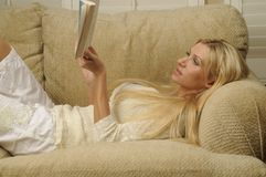Woman Reading. And enjoying a good book Stock Photos
