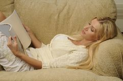 Woman Reading. And enjoying a good book Royalty Free Stock Photos
