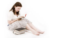 Woman reading. A beautiful young woman studying her books stock image