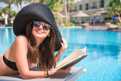 Woman Reading A Book By The Pool Royalty Free Stock Photo