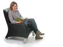 Woman reading in the armchair Stock Photo