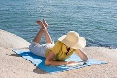 Free Woman Reading At The Sea Stock Photo - 14133270
