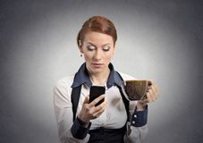Woman reading bad news on smartphone drinking coffee. Closeup portrait serious worried business woman reading bad news on smart phone holding mobile drinking cup Stock Photos