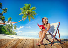 Woman Reading on a Beach Stock Photo
