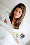 Woman reading in bed Royalty Free Stock Images