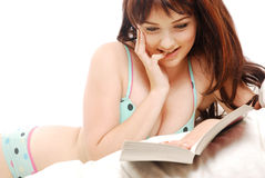 Woman reading in bed Royalty Free Stock Photos