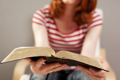Woman Reading the Bible stock images