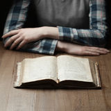 Woman reading the bible in the darkness Royalty Free Stock Photo