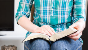 Woman Reading the Bible at Home Stock Image