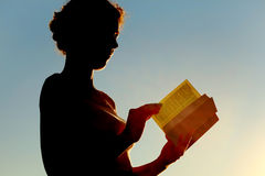 Woman reading bible and turning page Royalty Free Stock Image