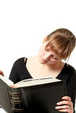 Woman reading big book Royalty Free Stock Photography
