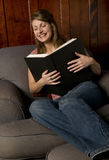 A woman reading a big book Royalty Free Stock Photos