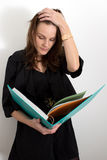 Woman Reading From A Blue Binder. And Looking Stressed Stock Photography