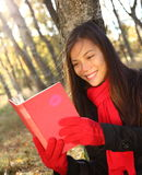 Woman reading book Stock Photo