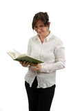 Woman reading a book. A woman with glasses is reading a book Stock Photos