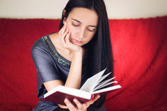 Woman reading a book Stock Image