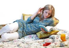 Woman is reading book. Separate on white Royalty Free Stock Photography