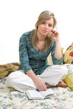 Woman is reading book. Separate on white Royalty Free Stock Photo