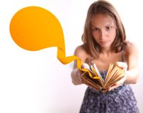 Woman reading a book,. Young woman reading a book with ribbon bookmark Stock Photography