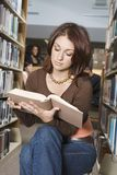 Woman Reading A Book Stock Images
