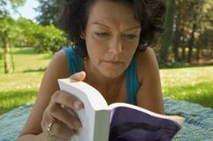 A woman reading a book. A woman reading a book royalty free stock photography