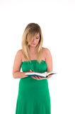 Woman reading book. Pretty woman in green dress stood reading book, isolated on white background Stock Photos