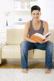 Woman reading book Stock Images