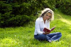 Woman reading book. In nature Royalty Free Stock Photo