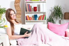 Woman Reading Book At Home Royalty Free Stock Image