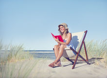 Woman Reading Book at Beach.  Stock Image