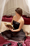Woman Reading Book On Bed Royalty Free Stock Photos